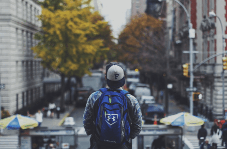boy looking at road with cheap backpacks